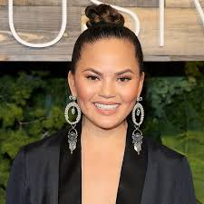 plastic hair chrissy teigen on plastic surgery byrdie