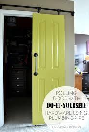 How To Build Sliding Barn Door by Diy Rolling Door Hardware Using Plumbing Pipe Jenna Burger