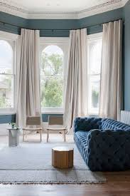 best 25 bay window curtain rod ideas on pinterest bay window prahran residence by hecker guthrie www heckerguthrie com photo shannon mcgrath blue velvet sofablue sofascurtain railsbay window curtain rodlinen