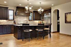 dark kitchen cabinets with light granite countertops island
