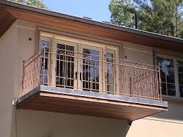 winning wrought iron balcony railings featuring brown stained