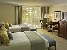 elegant guest bedroom woth double beds and benches with seating