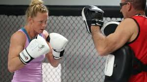 solar plexus punch boxing judo chop holly holm from nudges to knockouts bloody elbow