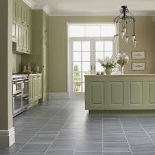 cute brown color natural stone tile kitchen floor features white