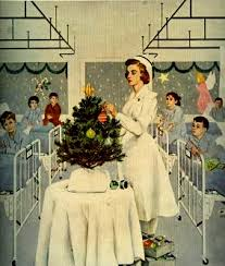 nurse getting the little christmas tree in the hospital ready