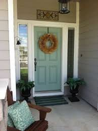 the 7 most welcoming colors for your front door tan house front