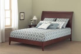 brown varnished walnut wood bed frame with sleigh headboard of