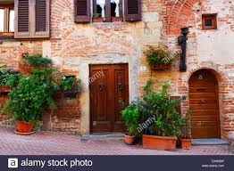 tuscany house wooden doors on tuscany houses in medieval town of certaldo alto