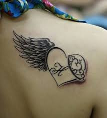 memorial tattoos design on back of heart with wings memorial