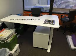 ikea bekant sit stand electric adjule height desk with galant file cabinet assembled in arlington