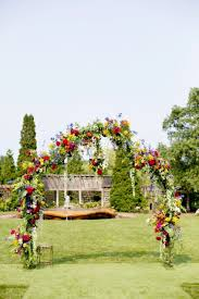 flower arch bliss weddings events organic garden wedding partyslate
