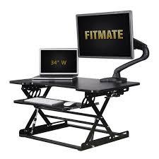 using a sit stand desk shop for fitmate standing desk converter 34 height adjustable