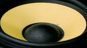 colors close to yellow close up at moving sub woofer speaker part black and yellow colors
