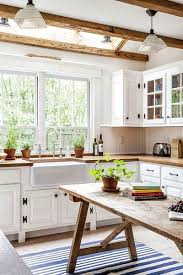 kitchen with white cabinets and wood countertops 27 kitchens with wood counters décor outline