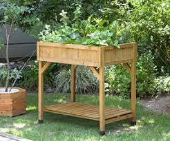 eartheasy bloggardening on concrete with raised beds and patio