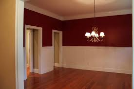red wall paint colour combination with maroon comforter for