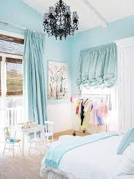 shabby chic bedroom ideas with pale blue curtain and white bed