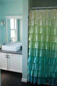 soft turquoise bathroom with ruffled shower curtain bath ideas