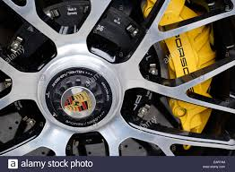 porsche logo porsche wheel with yellow brake caliper showing the porsche logo