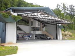 two tiered garage inside of an s style steel building future