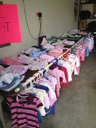 16 garage sale tips to make hundreds thousands at our next garage sale easy way to hang kid clothing and not take up any extra space