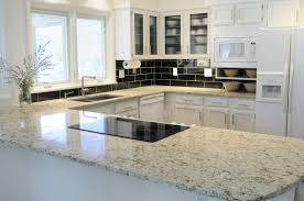 countertops black subway tile backsplash white glass cabinet black subway tile backsplash white glass cabinet doors white kitchen appliances induction stove top white frame kitchen window marble countertop