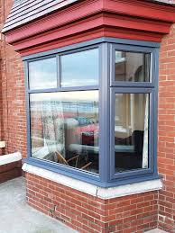 full house of anthracite grey windows with red composite door anthracite grey bay window with top and side openings
