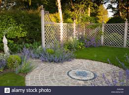 mosaic paving flowering plants sculpture and trellis in stock