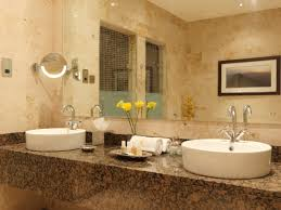 Hotel Bathroom Mirrors by Classy Double White Round Bowl Sink On Brown Granite Countertop