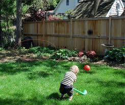 backyard garden along fence outdoor furniture design and ideas