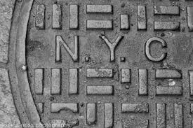black and white nyc new york city manhole sewer cover sign art