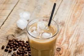 Wooden Desk Background Coffee Ice Cubes And Beans With Latte On Wooden Desk Background