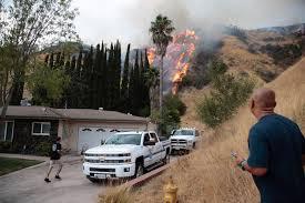California Wildfires Burn Cars by Residents Worry Keep Faith As Los Angeles Brushfire Burns Near