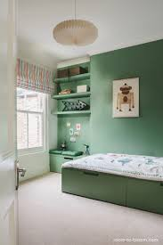 green is great for a kids bedroom with such a simple bedroom this