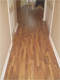 cost of hardwood flooring cost per sq ft to install laminate
