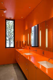 attractive orange bathroom vanity with orange storage and orange
