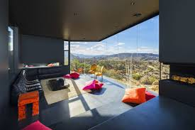 fireplace living room floor to ceiling windows mountain home in