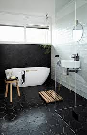 black hexagon tiles on the floors and walls for a masculine