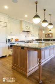 open concept kitchen with large granite island photo by jeff