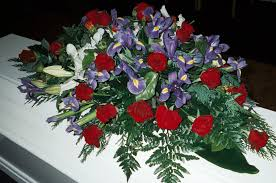 casket spray beautiful casket spray with blue iris roses white lilies and