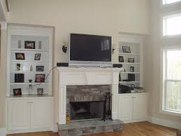 mounting a tv on brick above a fireplace with mounting tv above