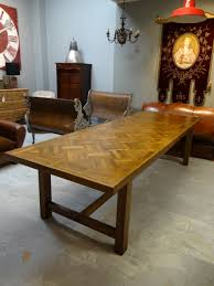 a stunning oak parquet dining table that can sit 10 12 people