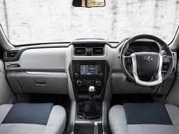 scorpio car new model 2013 2015 tata safari storme vs 2014 mahindra scorpio comparison