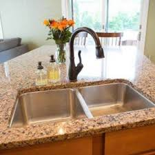 black faucet with stainless steel sink double stainless steel sinks with bronze faucet and granite