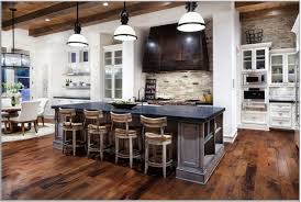 great country kitchen design with dark laminated wood flooring and