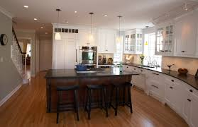 white kitchen with black island 35 striking white kitchens with wood floors pictures