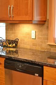 kitchen backsplash made of beige ceramic tiled mixed glass mosaic