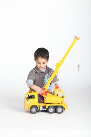 bruder toys logo amazon com bruder man crane truck toys u0026 games