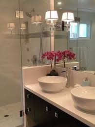 this vanity looks so crisp and clean with the contrast between the