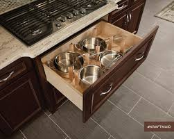 the scoop top drawer fits under the cooktop and provides pots and
